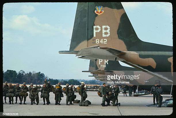 Paratroopers of the 82nd Airborne Division prepare to board an aircraft at Pope Air Force Base at Fort Bragg.