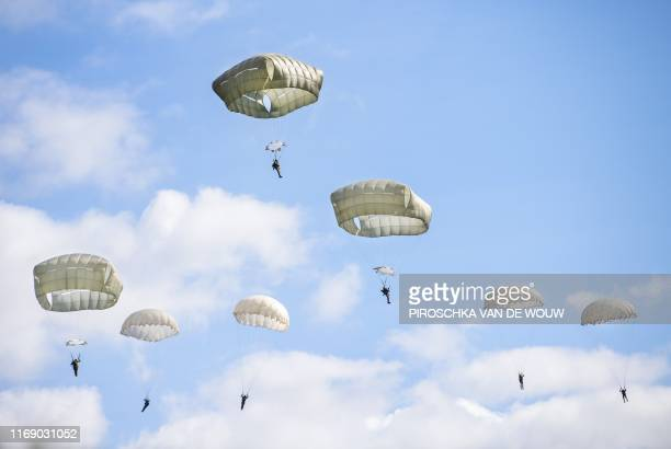 Paratroopers parachute from an original C-47 Dakota during the commemoration of the Operation Market Garden that was conducted 75 years ago, on...