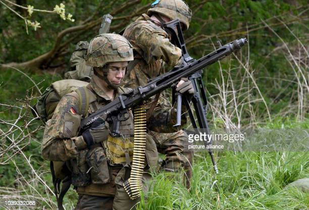 Paratroopers prepare for a mission after jumping out of a Transall transport plane over Ahrenvioelfeld Germany 10 May 2017 Around 3500 German and...
