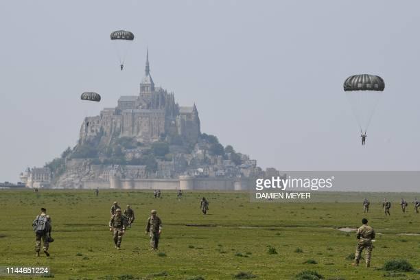 TOPSHOT US paratroopers walk back after jumping over Le MontSaintMichel northwestern France on May 18 less than three weeks before the 75th...