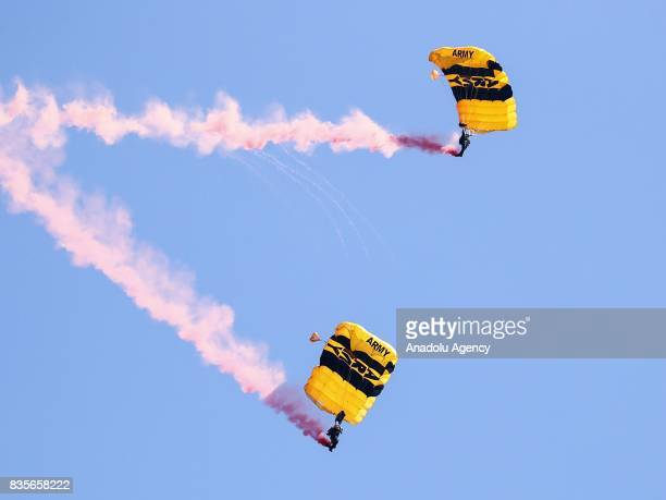 Paratroops perform during the 59th Chicago Air and Water Show which is watched by about two million people at North Avenue Beach and around over Lake...