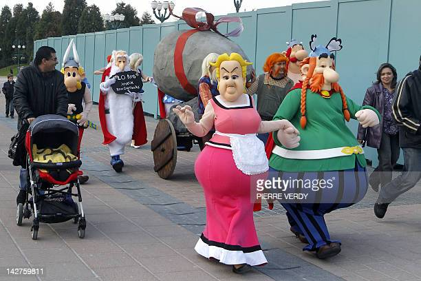 Parc Asterix resort characters arrive at the entrance of the Euro Disney park on April 12 2012 in MarneLaVallee outside Paris to offer a menhir in...