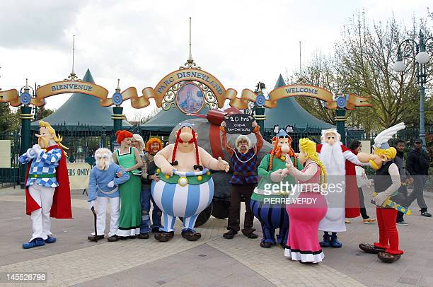 Parc Asterix resort characters pose in front of the entrance of the Euro Disney park on April 12 2012 in MarneLaVallee outside Paris to celebrate the...