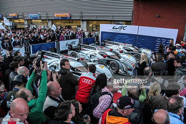 Parc ferme in the pitlane with the, #2 and LMP1 class cars Audi Sport Team Joest Audi R18 e-tron quattro lined up after winning and claiming all...