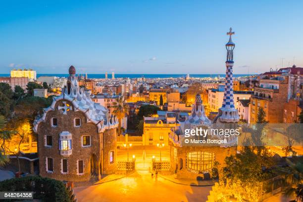 parc guell at dusk, barcelona. - barcelona spain stock photos and pictures