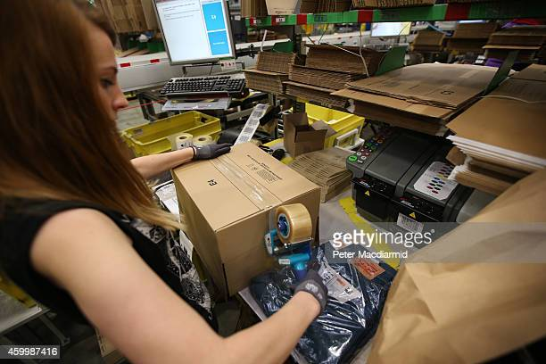 A parcel is prepared for dispatch at Amazon's warehouse on December 5 2014 in Hemel Hempstead England In the lead up to Christmas Amazon is...