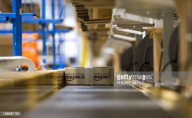 A parcel is seen on a conveyor belt before being shipped to a client on December 13 2012 on the site of the online retailer Amazon in ChalonsurSaone...