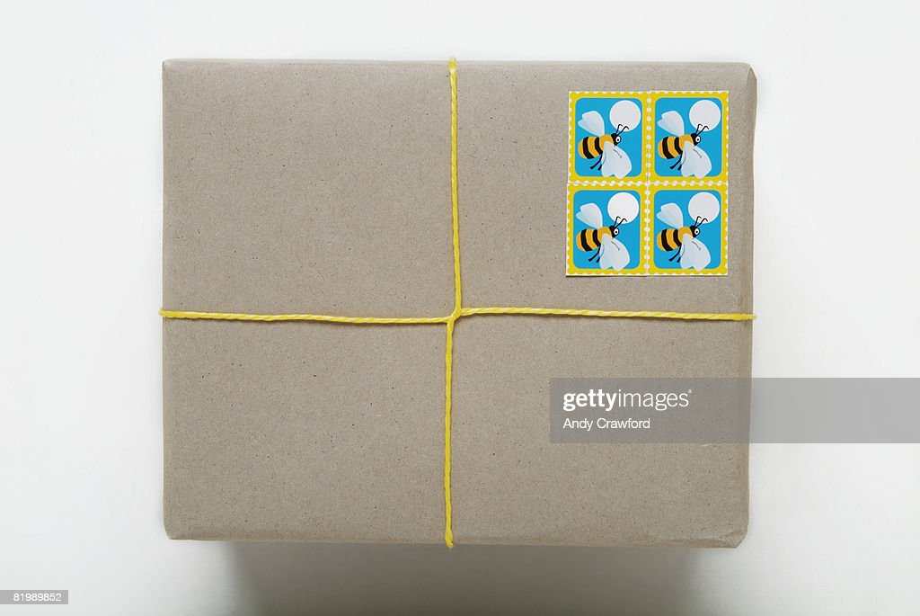 Parcel tied with yellow string, close up : Stock Photo