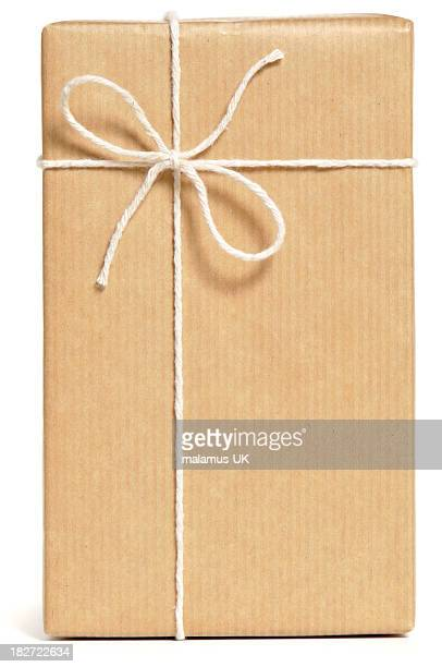 A parcel wrapped in brown paper and tied with white string