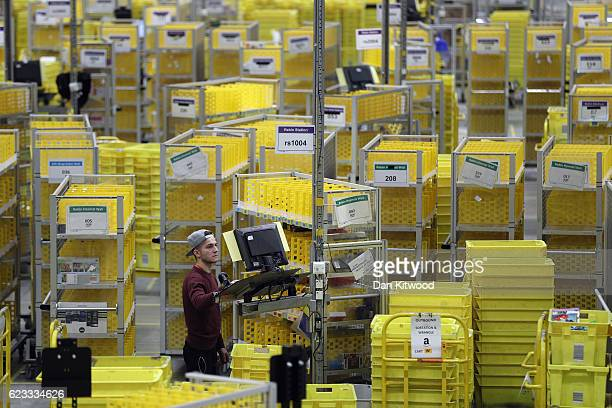 Parcels are processed and prepared for dispatch at Amazon's fulfillment centre on November 15, 2016 in Peterborough, England. In the lead up to...