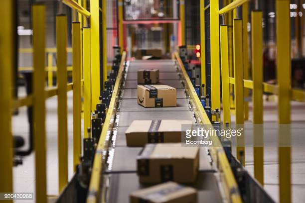 Parcels containing customers' goods ordered online using the 'Prime' service move along an automated conveyor belt at Amazoncom Inc's new fulfillment...