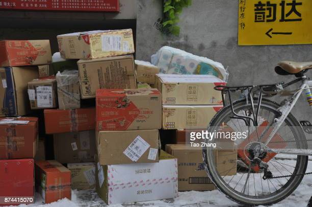 Parcels from Singles Day online shopping event are seen at a temporary tent in Heilongjiang University in Harbin city northeast China's Heilongjiang...