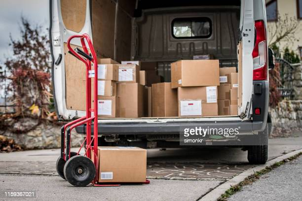 parcels in delivery van - large group of objects stock pictures, royalty-free photos & images