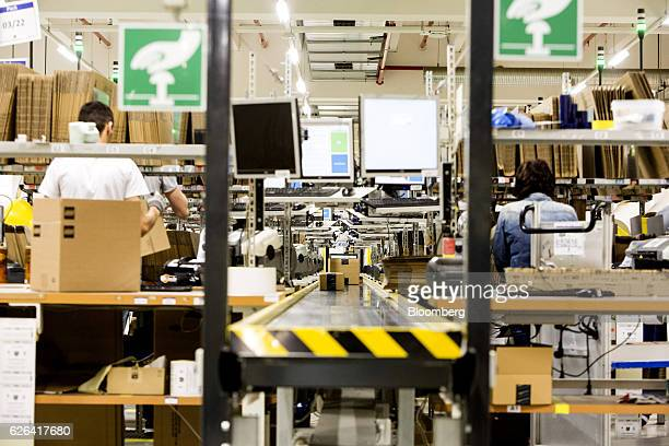 Parcels move along a conveyor in the packaging area of an Amazoncom Inc fulfillment center in Koblenz Germany on Tuesday Nov 29 2016 Ecommerce sales...