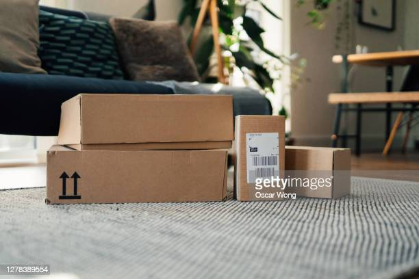 parcels on floor in a living room - national holiday stock pictures, royalty-free photos & images