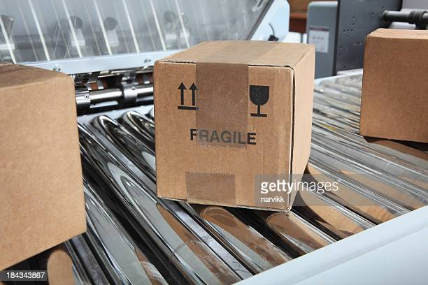 parcels on packaging line - fragile sign stock pictures, royalty-free photos & images