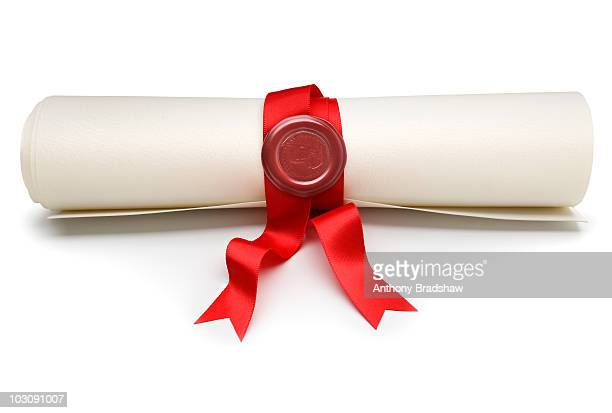 Parchment scroll with red ribbon and seal