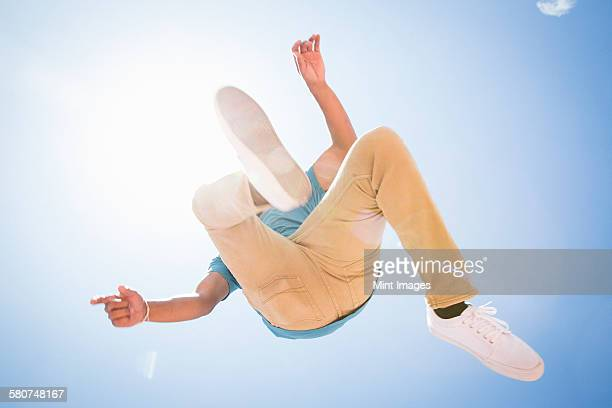 A parcour runner, young man jumping in the air.