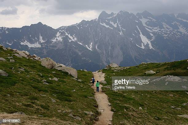 Parent and child hiking down a path on Mont Blanc