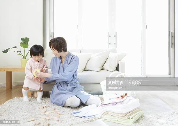 Parent and child in living room
