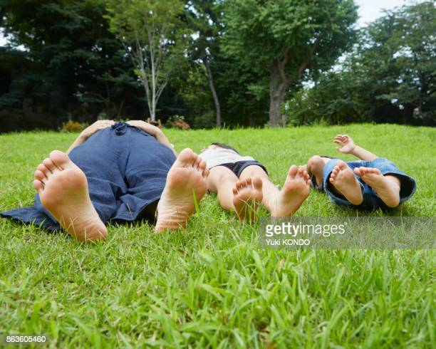 Parent and child lying on the grass