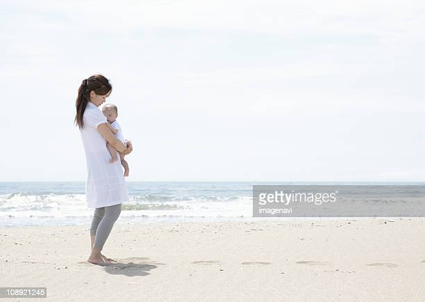 Parent and child on beach