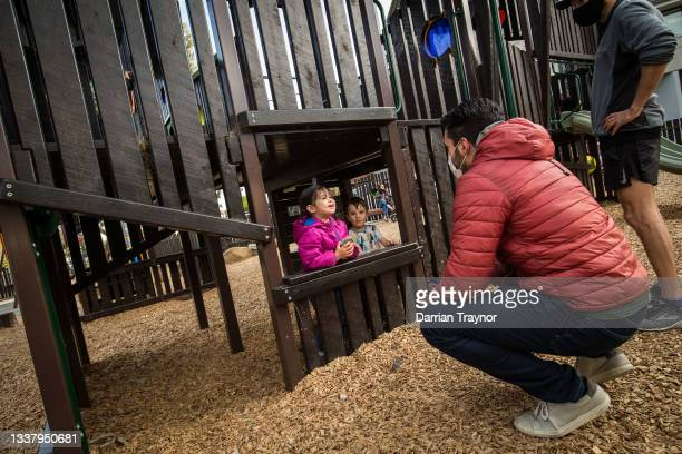 Parent and children enjoy time at a playground in Brunswick on September 03, 2021 in Melbourne, Australia. Victoria has recorded 208 new COVID-19...