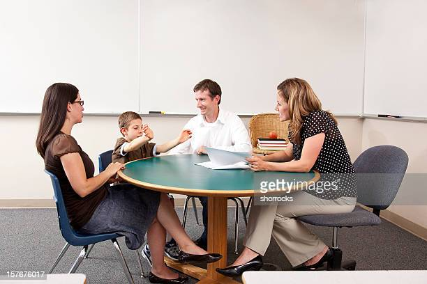 Parent and Teacher Conference in a Classroom