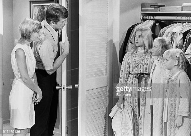 A parent child scene from the American TV series The Brady Bunch featuring from left Florence Henderson as Carol Brady Robert Reed as Mike Brady...