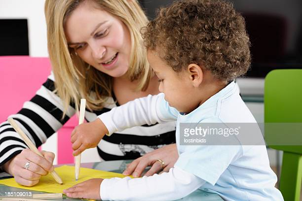 Parent Enjoying Drawing With Toddler