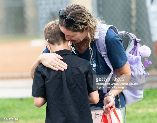 Parent gives her son a hug before sending him off to his first day of second grade at Laguna Niguel Elementary School in Laguna Niguel, CA on...