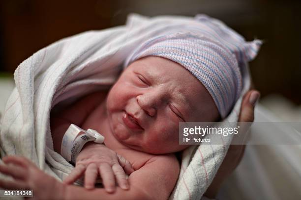 parent holding newborn baby (0-1 months) wrapped in blanket - 0 1 months stock pictures, royalty-free photos & images