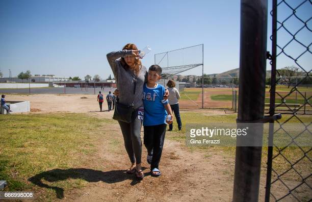 Parent hugs her child after being reunited hours after a shooting inside North Park Elementary School on April 10, 2017 in San Bernardino,...