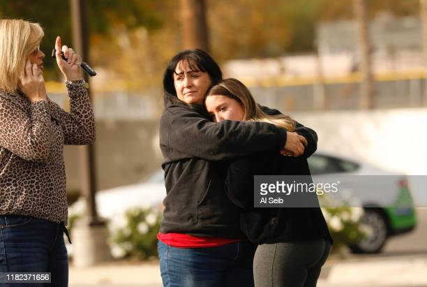 Parent is reunited with their child outside Saugus High School, where at least five people were injured two critically when a gunman opened fire on...