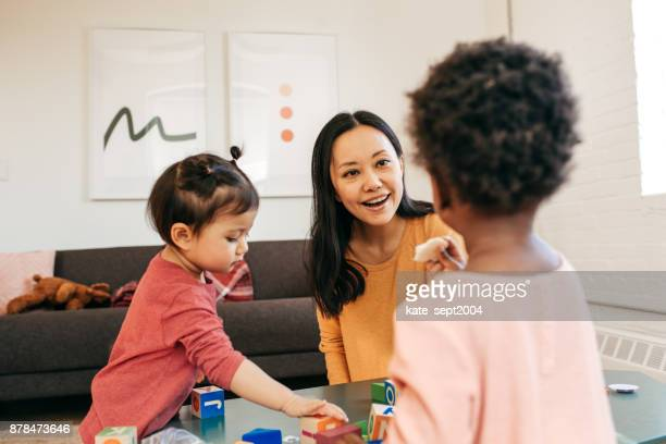 parent playing with toddlers - child care stock pictures, royalty-free photos & images