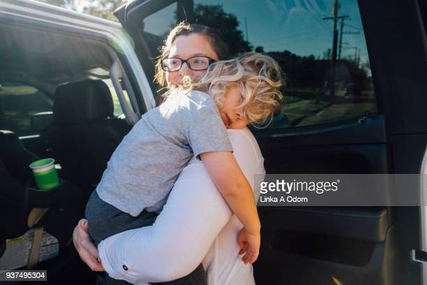 Parent removing Child from Car