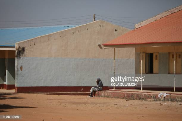 Parent sit outside the Government Science school after gunmen abducted students from it, in Kankara, in northwestern Katsina state, Nigeria December...
