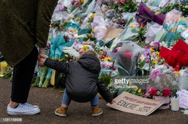 Parent takes their son to look at floral tributes left at Clapham Common bandstand where people continue to pay their respects to Sarah Everard on...