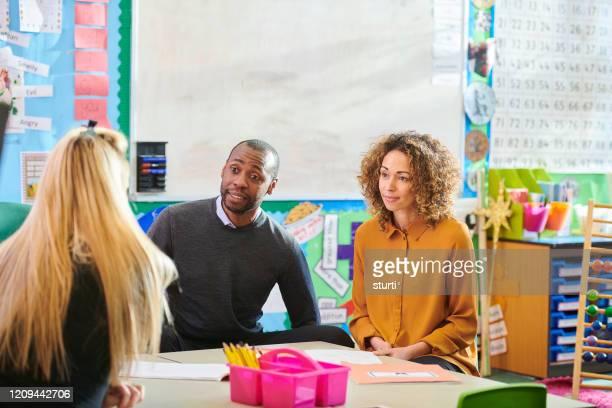 parent teacher meeting - parent stock pictures, royalty-free photos & images
