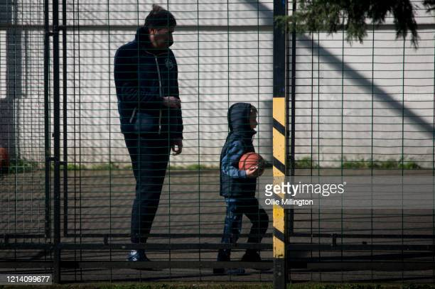 Parent with their child play in a roadside playground on March 22, 2020 in London, England. Coronavirus has spread to at least 188 countries,...