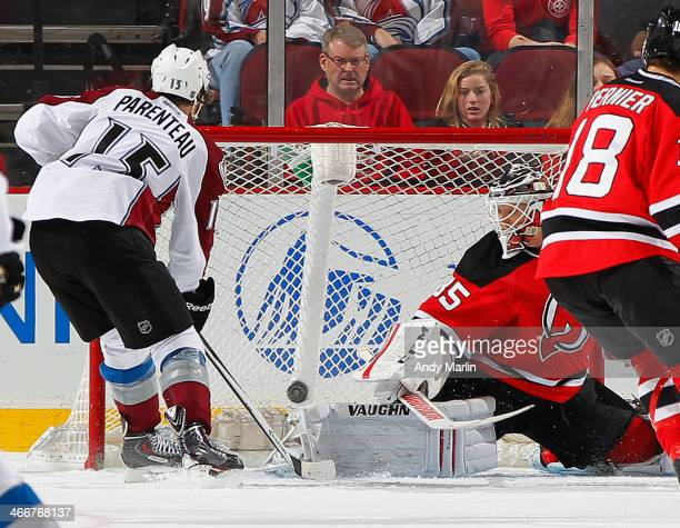 Parenteau of the Colorado Avalanche scores the gametying goal at 1813 of the third period against Cory Schneider of the New Jersey Devils during the...