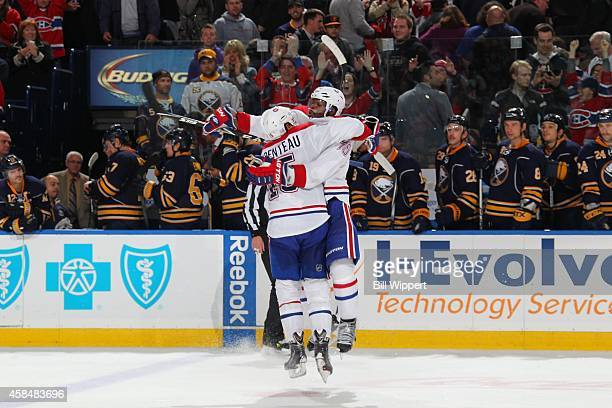 A Parenteau of the Montreal Canadiens jumps into the arms of teammate PK Subban to celebrate his game winning shootout goal against the Buffalo...