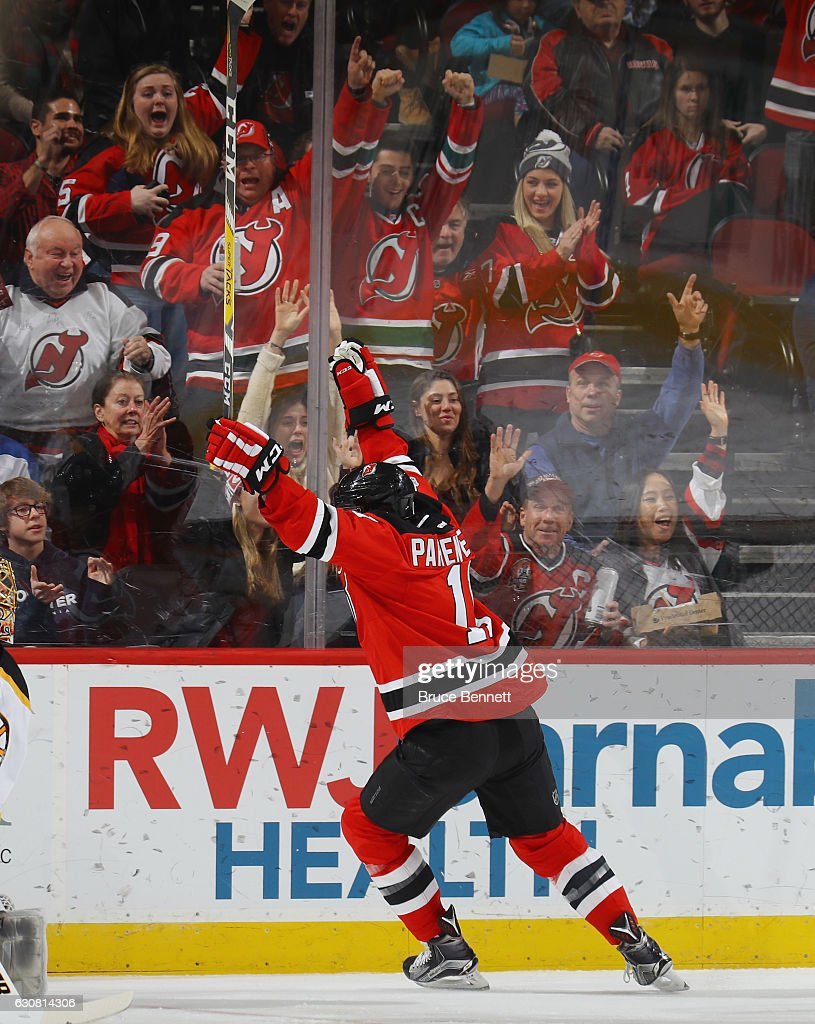 P.A. Parenteau #11 of the New Jersey Devils celebrates his goal at 4:12 of the first period against the Boston Bruins at the Prudential Center on January 2, 2017 in Newark, New Jersey.