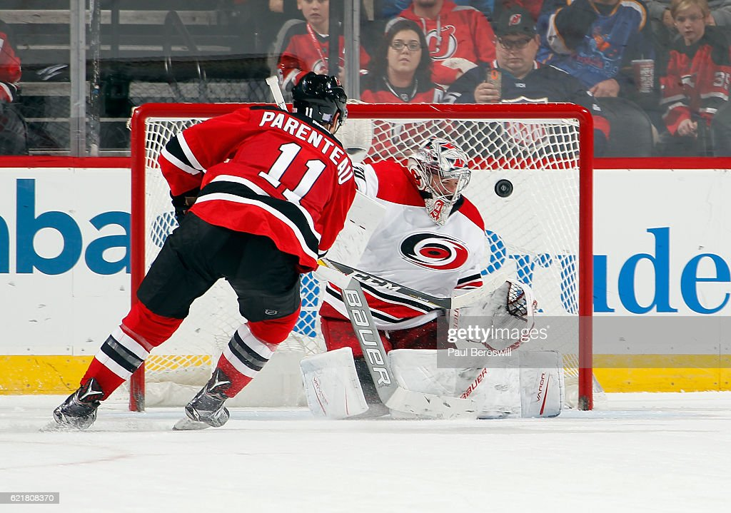 PA Parenteau #11 of the New Jersey Devils shoots the puck past goalie Cam Ward #30 of the Carolina Hurricanes for a goal in the shootout of their game at the Prudential Center on November 8, 2016 in Newark, New Jersey. Devils won 3-2 in a shootout.