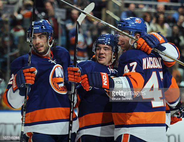 A Parenteau of the New York Islanders celebrates his goal at 1943 of the second period against the Tampa Bay Lightning along with Matt Moulson and...