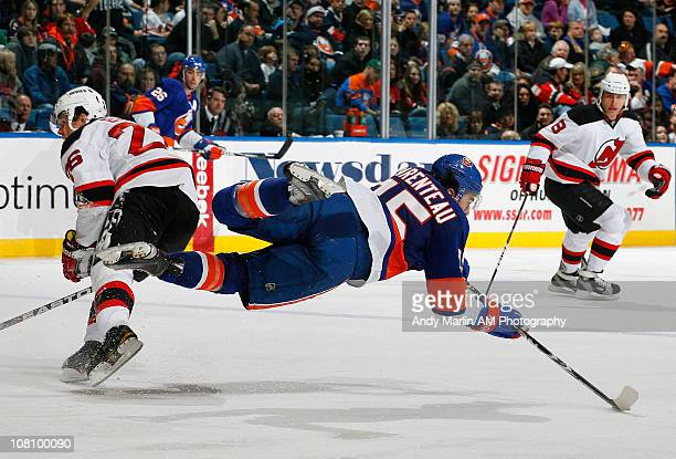 Parenteau of the New York Islanders goes airborne after being checked by Patrik Elias of the New Jersey Devils during the game at the Nassau Coliseum...