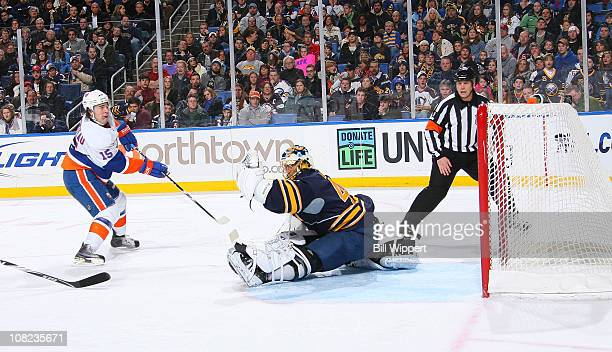 Parenteau of the New York Islanders scores a second period goal past Patrick Lalime of the Buffalo Sabres at HSBC Arena on January 21, 2011 in...