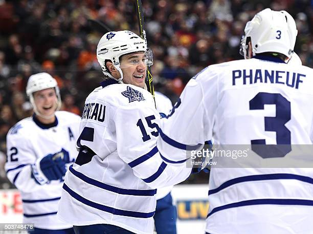 A Parenteau of the Toronto Maple Leafs celebrates his second goal of the game with Dion Phaneuf and Tyler Bozak to take a 20 lead over the Anaheim...