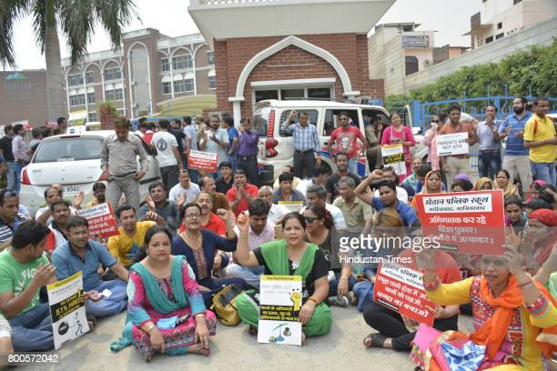 Parents and association members staged protest outside Khaitan Public School after the institution expelled 35 students for not depositing the...