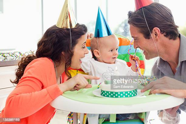 Parents and baby celebrating first birthday